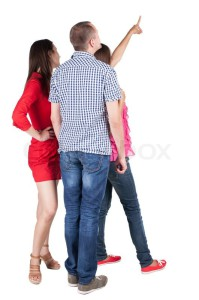 7386725-back-view-of-three-friends-pointing-group-of-people-watching-somewhere